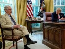 FILE PHOTO: U.S. President Trump hosts meeting to discuss coronavirus aid legislation at the White House in Washington