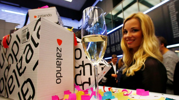 FILE PHOTO: A model stands next to a Zalando package during the initial public offering of the company at the Frankfurt stock exchange
