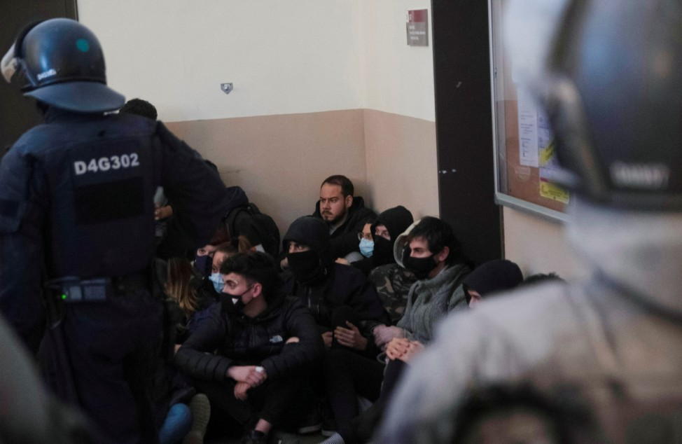 Spanish rapper Pablo Hasel is detained by riot police inside of University of Lleida