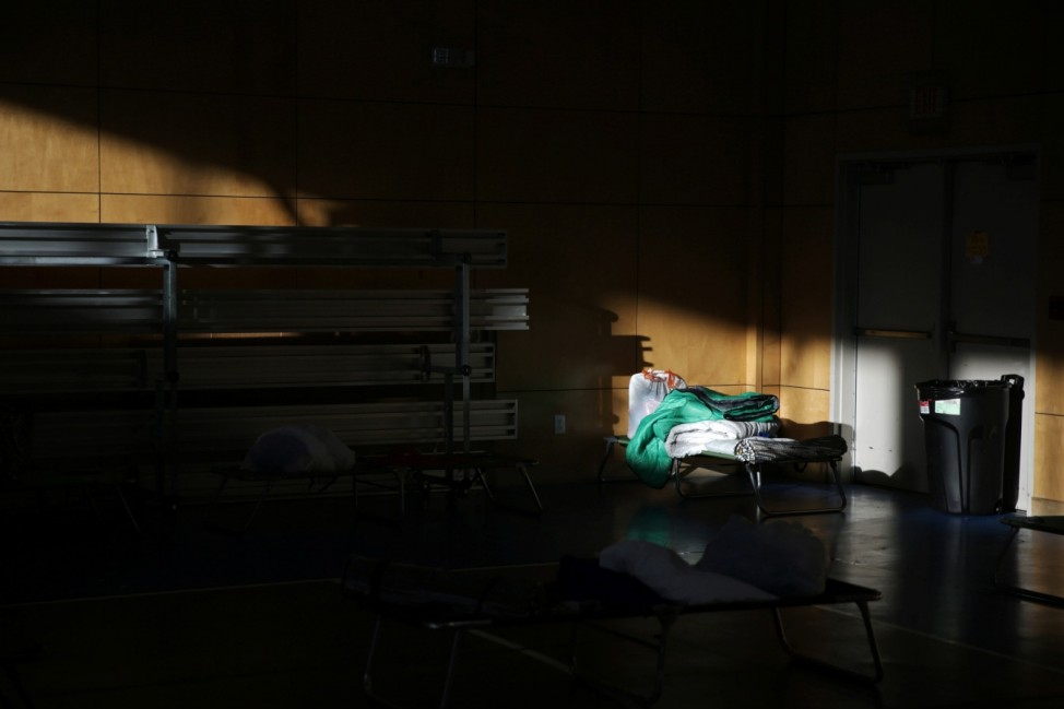 People take shelter at a Salvation Army facility after winter weather caused electricity blackouts in Plano