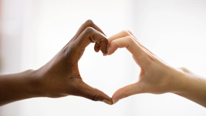 Multiracial Female Friend s Hands Showing Heart Shape Copyright: xAndreyPopovx Panthermedia27376342