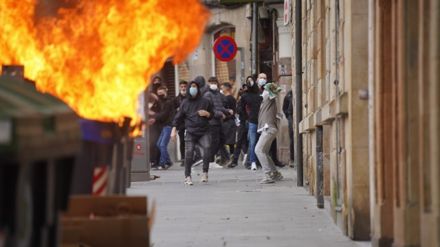 A container burns during riots at a demonstration against the imprisonment of Pablo Hasel on the sixth day of protests,