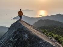 Trekking on top of Ilha Grande at sunrise Rio de Janeiro Brazil Rio de Janeiro RJ Brazil model re