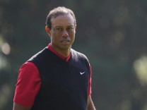 Tiger Woods walks off of the 6th green in the final round of the 2020 Masters golf tournament at Augusta National Golf