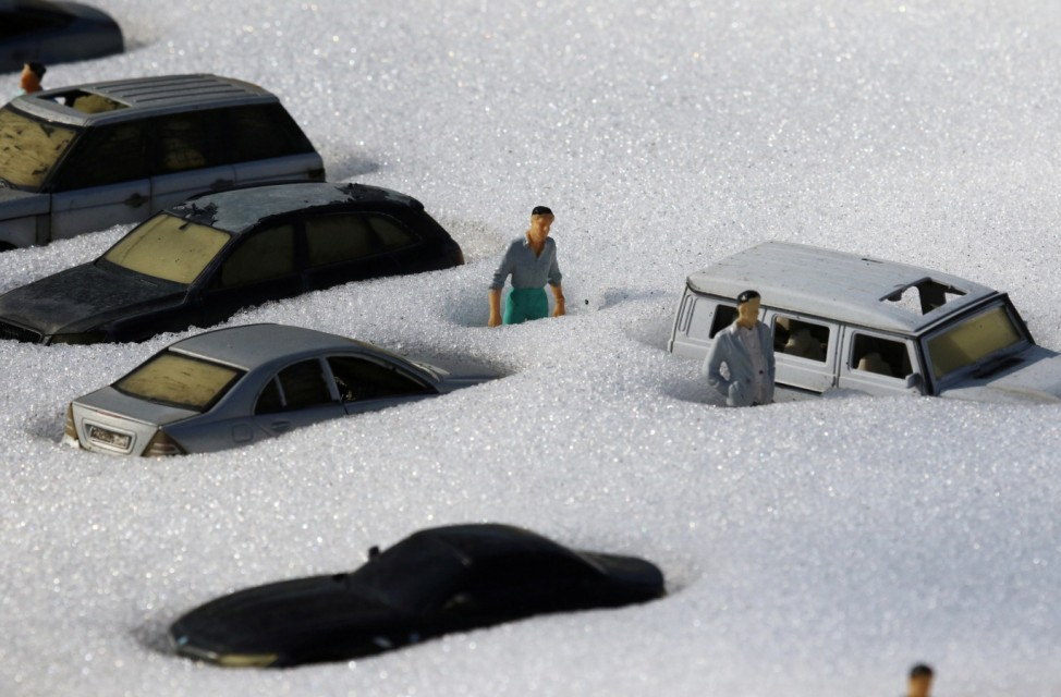 Snow covered figures are pictured at a local park of miniatures in Bakhchisaray