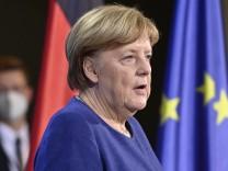 Coronavirus weltweit: Merkel stellt Impfpässe bis zum Sommer in Aussicht