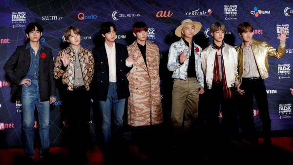 FILE PHOTO: Members of South Korean boy band BTS pose on the red carpet during the annual MAMA Awards at Nagoya Dome in Nagoya