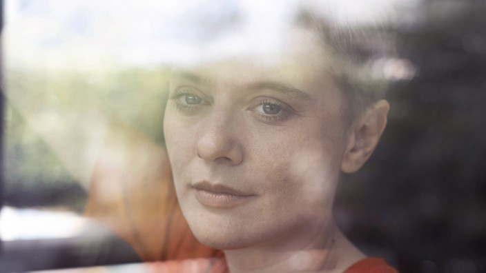 Close-up of thoughtful mid adult woman at home seen through window model released Symbolfoto property released UUF21301
