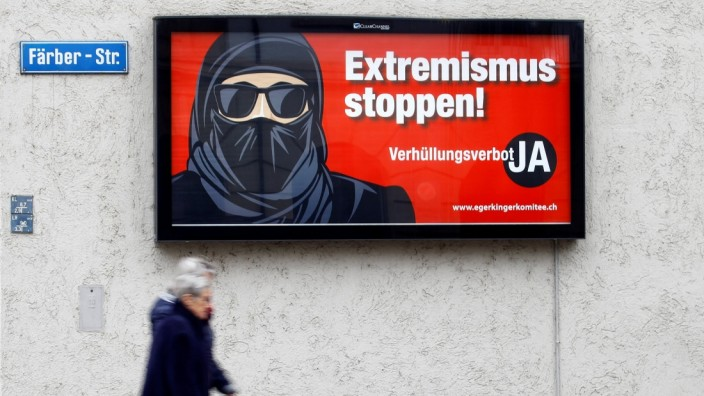 A poster of the initiative committee against wearing the Burka is seen in Zurich