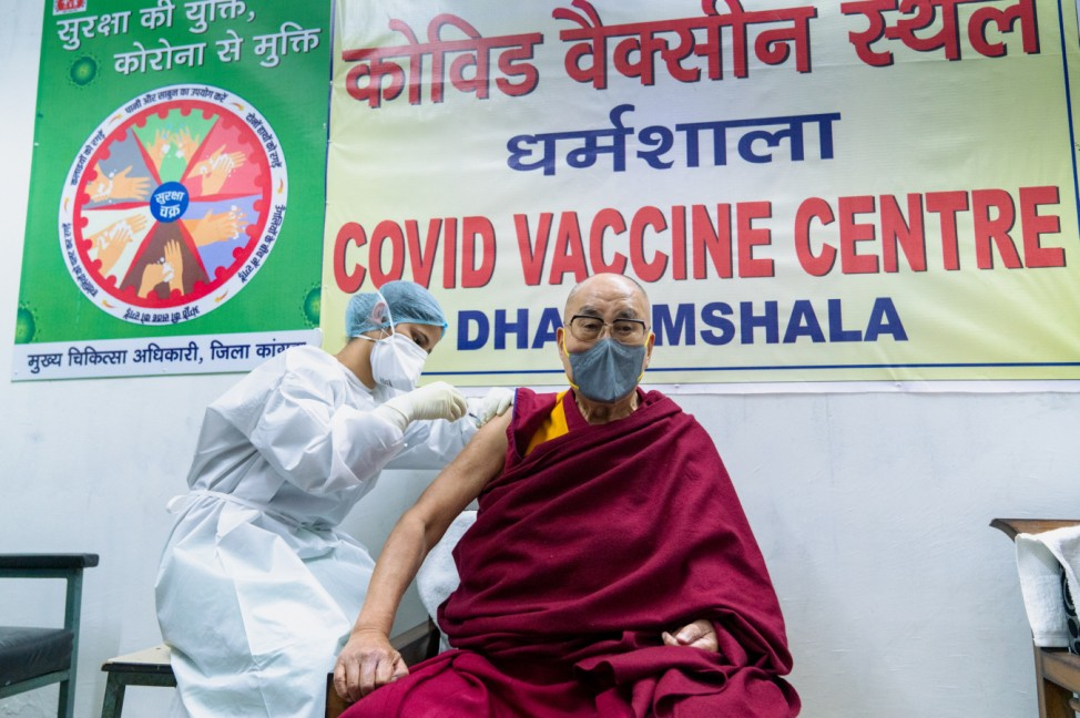 The Dalai Lama receives a dose of coronavirus disease (COVID-19) vaccine at a vaccination centre in Dharamsala
