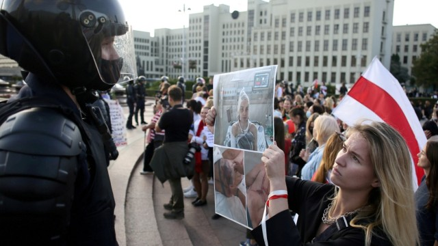 FILE PHOTO: Women take part in a rally against police brutality following protests to reject the presidential election results in Minsk