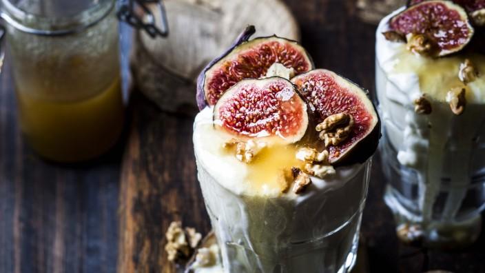 Glasses of Greek yogurt with honey, figs and walnuts SBDF04371