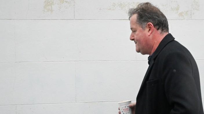 Piers Morgan walks near his house in London