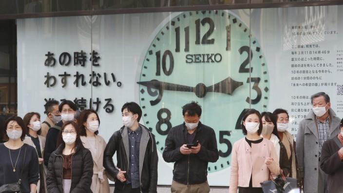 Japan nach Fukushima: Uhr in Tokio mit der Uhrzeit des Seebebens
