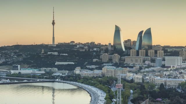 Azerbaijan, Baku, high angle city skyline, from the north, dusk. (Walter Bibikow)