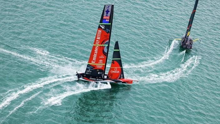 (210316) -- AUCKLAND, March 16, 2021 -- Emirates Team New Zealand (L) and Luna Rossa Prada Pirelli of Italy sail during