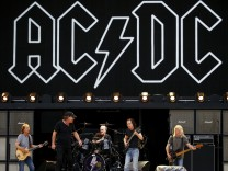 Members of the rock group AC/DC Stevie Young, Brian Johnson, Chris Slade, Angus Young and Cliff Williams perform during a rehearsal at Stadium Australia in Sydney, Australia