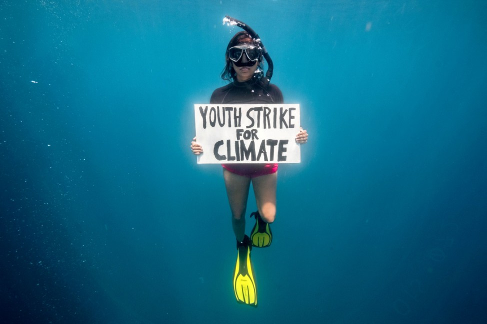Mauritian scientist and climate change activist Shaama Sandooyea 24, holds a placard reading Youth Strike For Climate, during an underwater protest at the Saya de Malha Bank