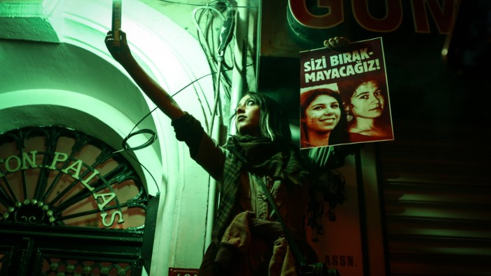 March 8, 2021, Istanbul, Turkey: A demonstrator lights a flare and holds placard during International Women s Day celeb