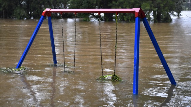 NSW WET WEATHER, A semi-submerged child'!s playground on the banks of the flooded Nepean River at Trench Reserve at Penri