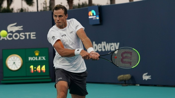 MIAMI GARDENS, FL - MARCH 24: Vasek Pospisil (CAN) hits a backhand during the first round match of the Miami Open on Ma