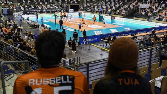 People attend a volleyball game after taking COVID-19 tests in Berlin