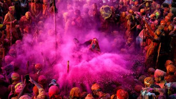 March 24, 2021, Mathura, Uttar Pradesh, India: Hindu devotees play with colourful powders (Gulal) at Radharani Temple o