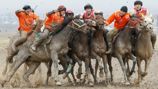 Kyrgyz riders take part in a Kok-Boru regional competition in the village of Sokuluk