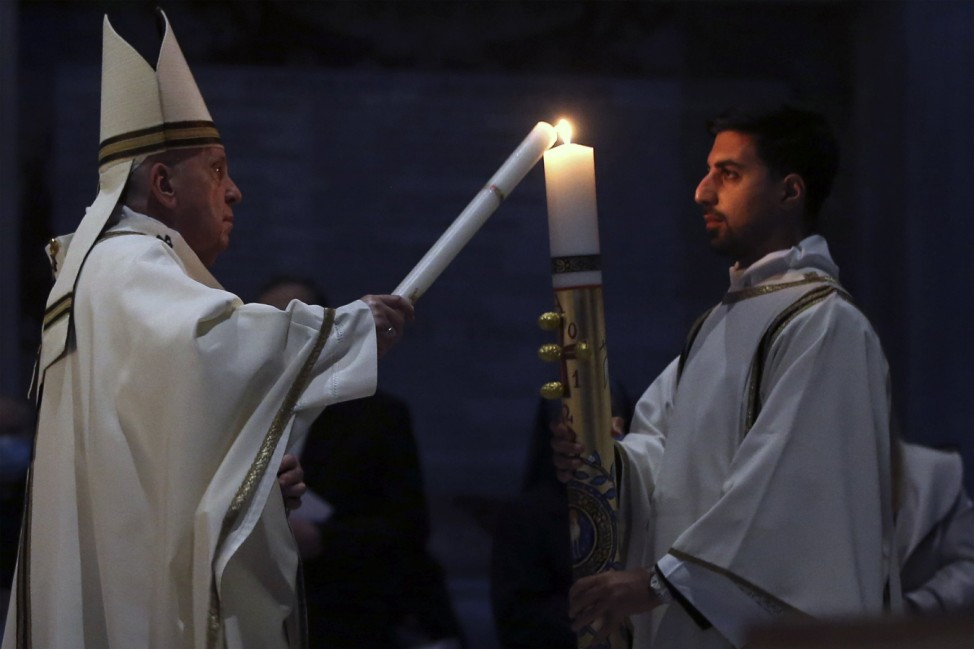 April 03, 2021 : Pope Francis celebrating the Easter Vigil at St. Peter s Basilica in The Vatican during the Covid-19 c