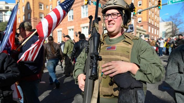 Pro and anti-gun lobbyists rally over sweeping state gun control legislation
