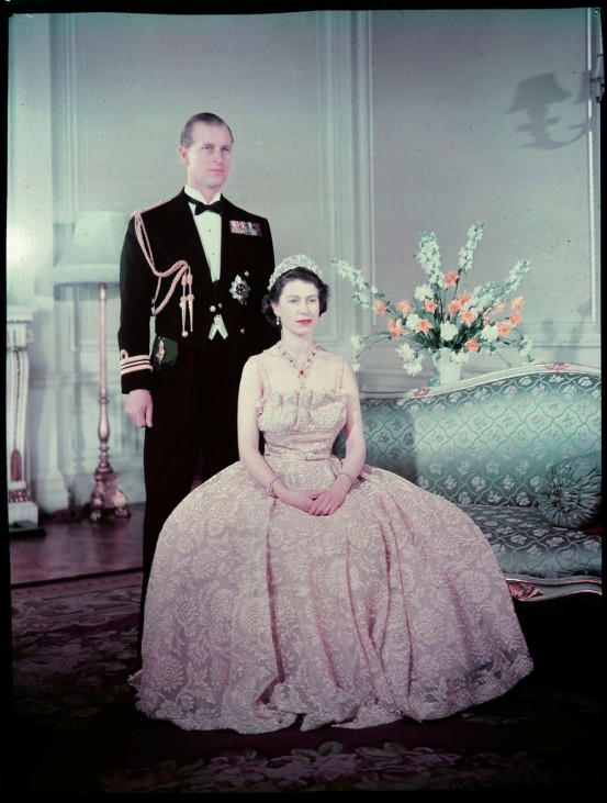 Queen Elizabeth II and Prince Philip pose  for a portrait at Buckingham Palace in London