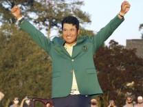 Golf: Masters Tournament Japanese golfer Hideki Matsuyama celebrates with the champion s green jacket after winning the