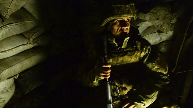 A service member of the Ukrainian armed forces is seen at fighting positions in Donetsk region