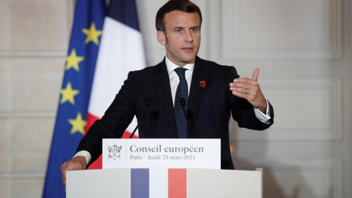 FILE PHOTO: French President Emmanuel Macron delivers a press conference after a European Council summit held over video-conference at the Elysee Palace in Paris