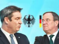 FOTOMONTAGE: Machtkampf zwischen Markus SOEDER (Ministerpraesident Bayern und CSU Vorsitzender) und Armin LASCHET buhlen