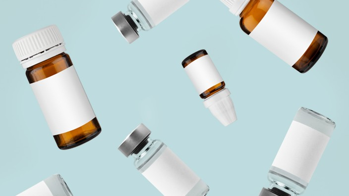 Falling,Injection,Vial,Glass,Bottles,With,White,Labels