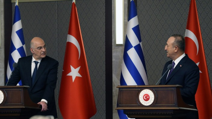 (210415) -- ANKARA, April 15, 2021 -- Turkish Foreign Minister Mevlut Cavusoglu (R) and Greek Foreign Minister Nikos De
