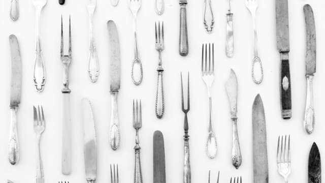 silver cutlery - vintage knife and fork on white background - beautiful decorated table (hanohiki)
