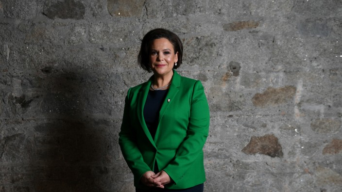 Sinn Fein's President-elect, Mary Lou McDonald, poses for a photograph before a special party conference, at which Gerry Adams will, following a vote, formally step down as President, in Dublin