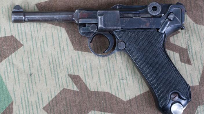 Luger P08 Parabellum handgun on camouflaged background (zm23)