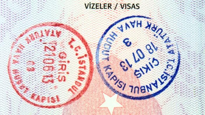 Visa stamps in Turkish passport close up image (hayatikayhan)