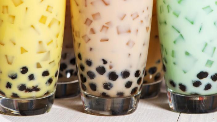 Bubble tea. Homemade Various Milk Tea with Pearls on wooden tabl Bubble tea. Homemade Various Milk Tea with Pearls on wo