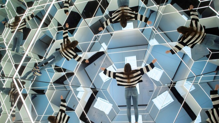 A woman visits the exhibition Mirrors In and Out of Reality in Barcelona Spain 12 April 2019 Mat