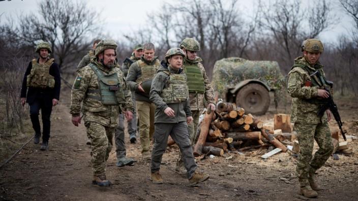 FILE PHOTO: Ukraine's President Volodymyr Zelenskiy visits positions of armed forces in Donbass region