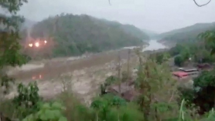 Video grab of fires seen on a forested hillside in Myanmar, seen across the Salween river from Mae Sam Laep, Thailand