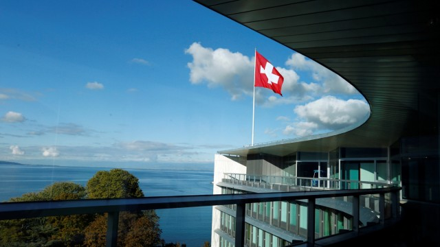 A Swiss flag is pictured on the headquarters building of world food giant Nestle in Vevey
