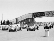 1950 British Grand Prix, Silverstone Giuseppe Farina (Alfa Romeo 158) leads at the start of the race Action, start shot; Motorsport