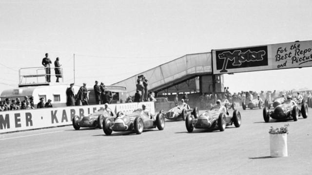 1950 British Grand Prix, Silverstone Giuseppe Farina (Alfa Romeo 158) leads at the start of the race Action, start shot; Motorsport