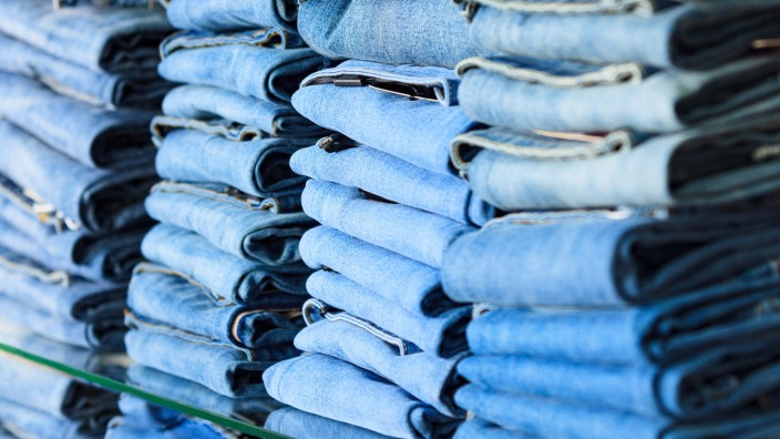 Closeup shot of stack of folded jeans in the fashion store (Nobilior)