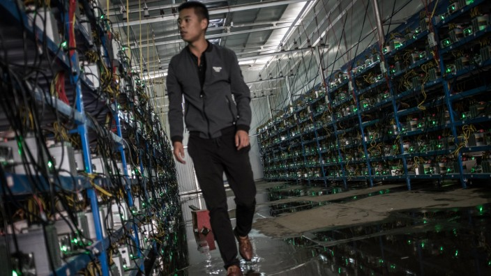 ABA CHINA SEPTEMBER 26 A worker inspects cryptocurrency mining rigs at a bitcoin factory on Sept